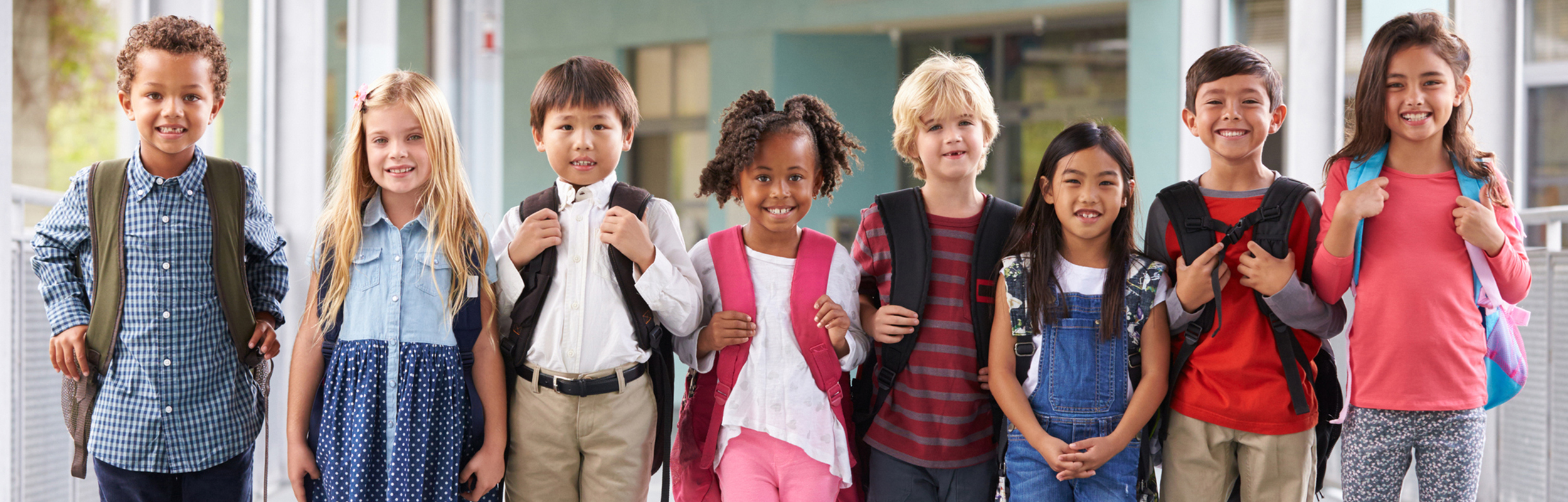 Students standing with backpacks on